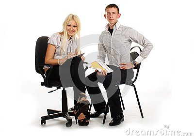 Businesswoman and man on office chair