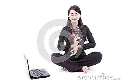 Businesswoman meditates peacefully