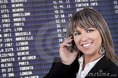 Businesswoman with mobile phone in airport