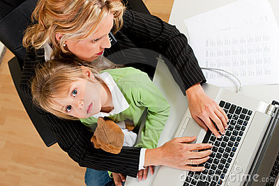 Businesswoman and mother is working at home