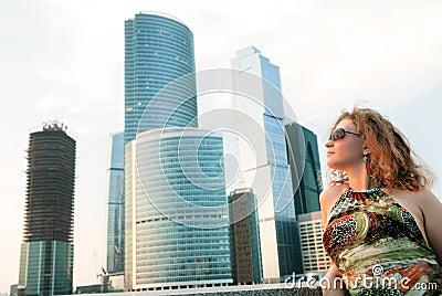 Businesswoman near modern buildings