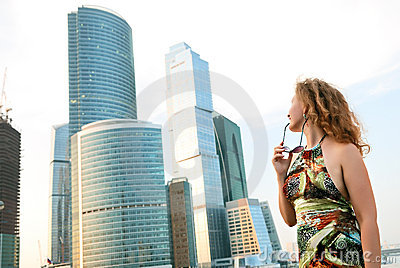 Businesswoman near modern buildings