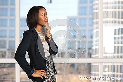 Businesswoman Near Office Window Thinking
