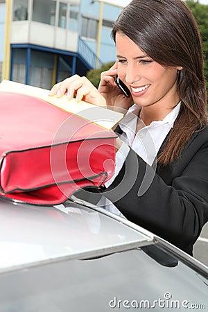 Businesswoman next to her car