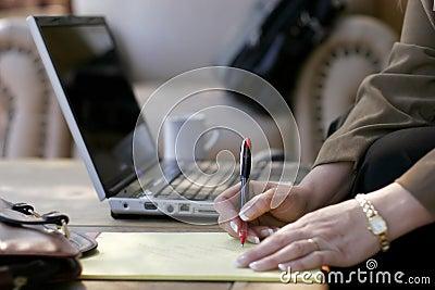 Businesswoman, Notes, Laptop, & Hotel Atrium