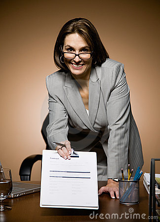 Businesswoman offering clipboard with contract