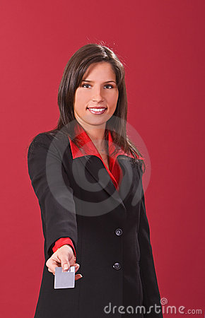 Businesswoman offering a credit card