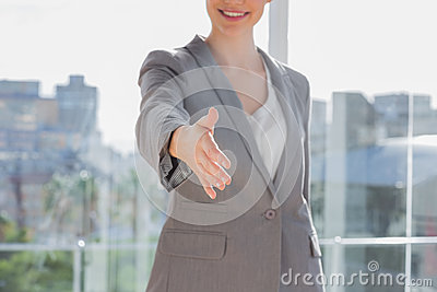 Businesswoman offering hand for handshake