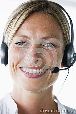 Businesswoman in office wearing headset