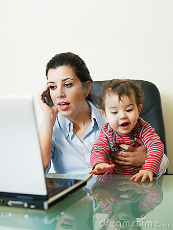 Free Businesswoman On The Phone, Holding Daughter Royalty Free Stock Photo - 12969945