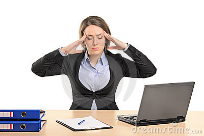 A businesswoman in pain as a result of a headache