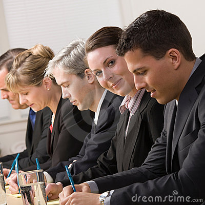 Businesswoman on panel of co-workers