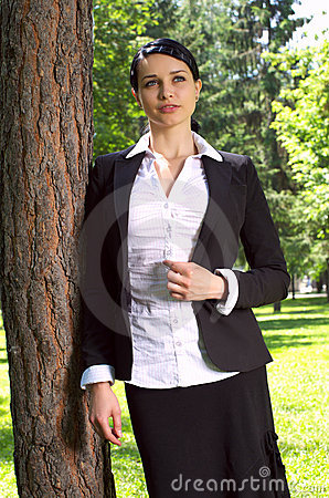 Businesswoman in the park Stock Photo