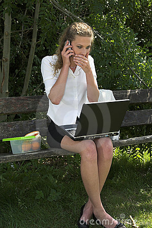 Businesswoman in the park; shock