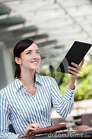Businesswoman Paying Bill