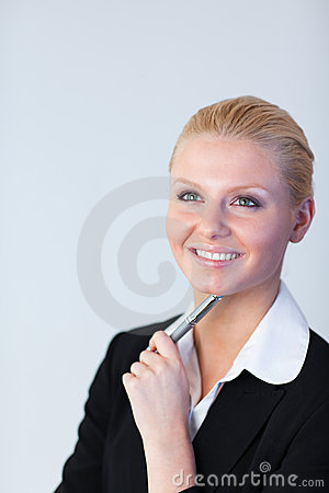 Businesswoman with pen in her hand
