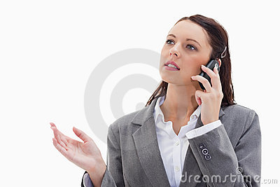A businesswoman on the phone explaining