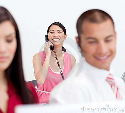 Businesswoman on phone with her colleagues