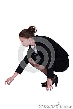 Businesswoman picking a speck