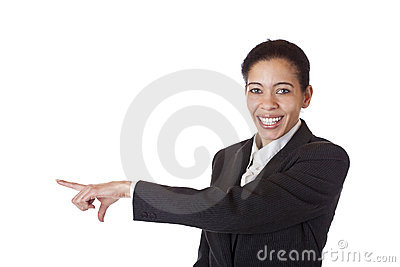Businesswoman pointing at blank copyspace