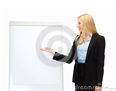 Businesswoman pointing at white blank flipchart