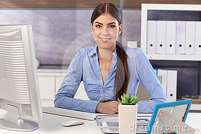 Businesswoman portrait at office desk