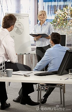 Businesswoman presenting idea in office