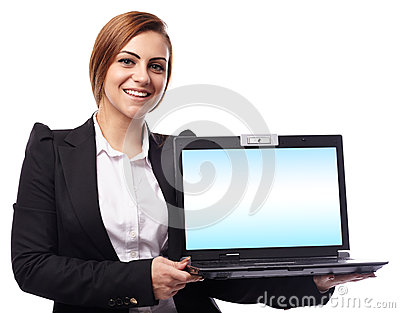 Businesswoman presenting a laptop with copyspace on the monitor