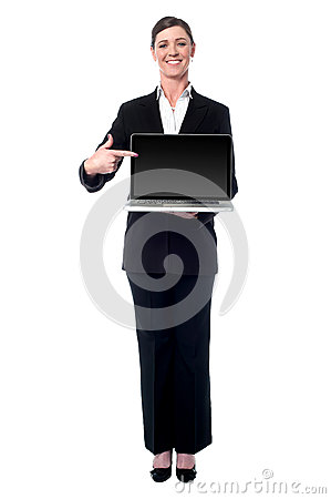 Businesswoman presenting new laptop