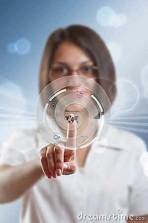 Businesswoman pressing modern buttons