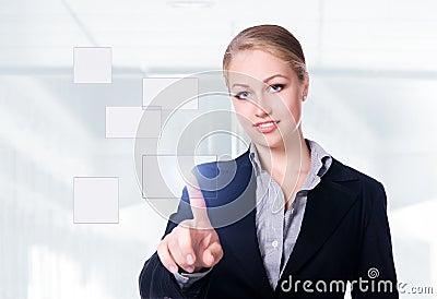 Businesswoman pressing a touchscreen button