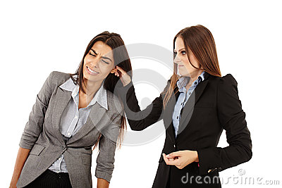 Businesswoman pulling colleague s ear