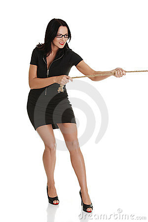 Businesswoman pulling on a rope