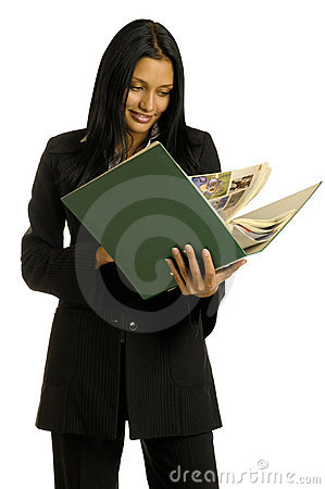 Businesswoman is reading the big book