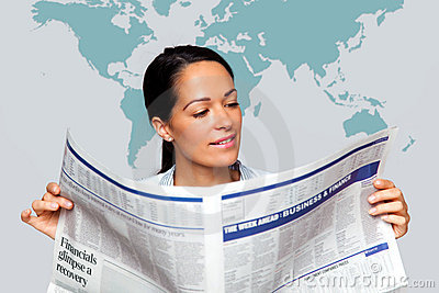 Businesswoman reading a financial newspaper