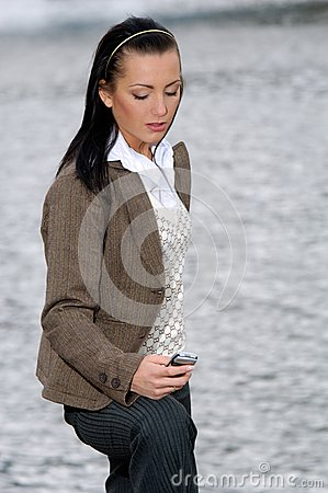 Businesswoman reading message