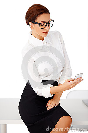 Businesswoman reading a text message
