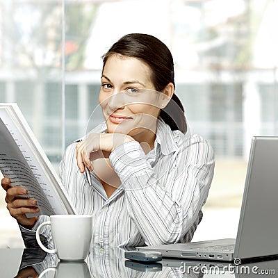 Businesswoman reads document