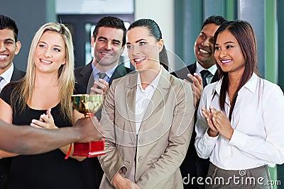 Businesswoman receiving trophy