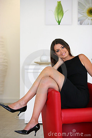 Businesswoman in red armchair