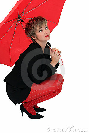 Businesswoman with a red umbrella
