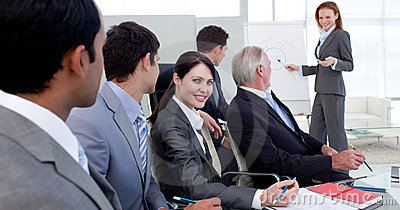 Businesswoman reporting sales figures to her team