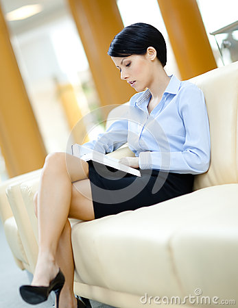 Businesswoman rests at the sofa