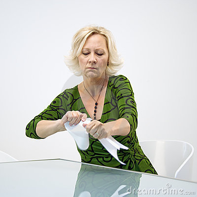 Businesswoman ripping papers