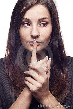 Businesswoman saying shh