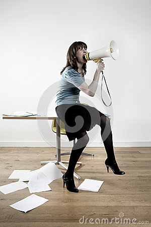 Businesswoman Screaming Into Megaphone