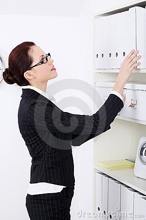 Businesswoman searching files.