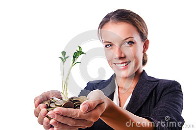Businesswoman with seedling