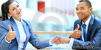 Businesswoman shaking hand to partne