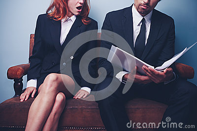Businesswoman is shocked after reading document